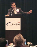 Dr. Mehta at podium