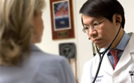 Dr. Poon with Patient
