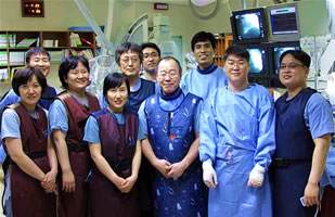 Dr. Saito with cath lab team