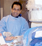 Dr. Sanjay Patel in cath lab doing a radial procedure